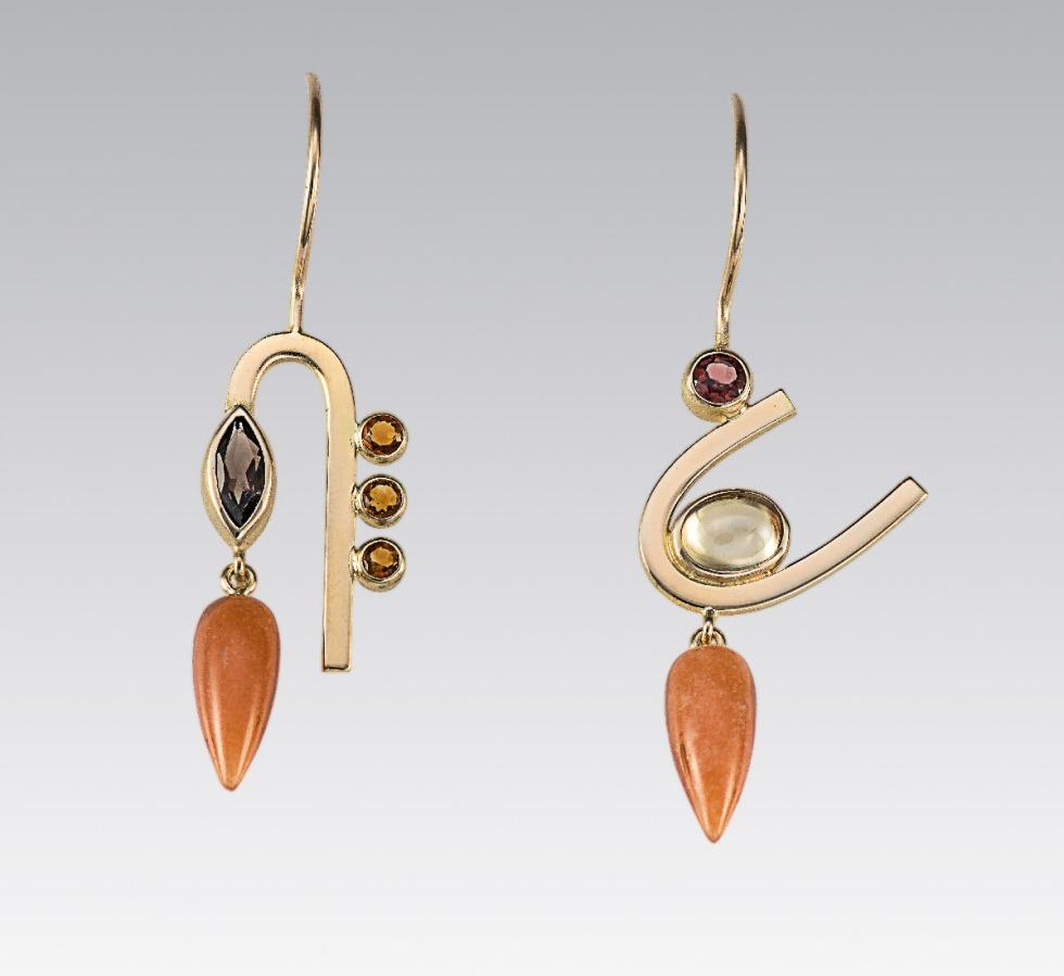 janis kerman mismatched earrings